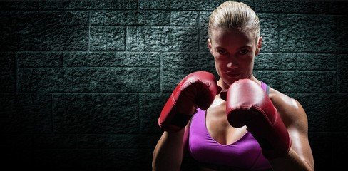 Composite image of portrait of woman fighter with gloves