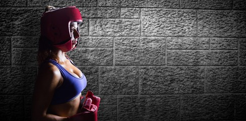 Female boxer with headgear and gloves