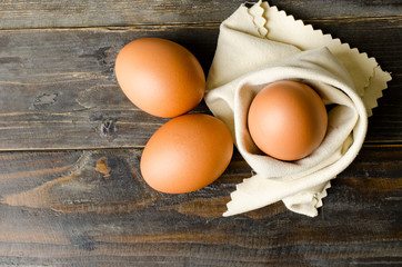 Fresh eggs on wooden background,food ingredient
