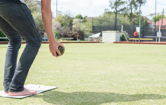 Male playing at bocce outdoor