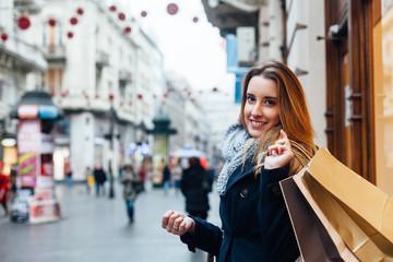 Beautiful woman carrying shopping bags