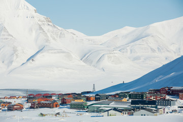 LONGYEARBYEN, SPITSBERGEN, NORWAY - 03 APRIL, 2015: Small town Longyearbyen among snow-capped mountains of the Norwegian archipelago of Svalbard.