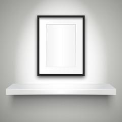 Empty shelf on wall and blank frame