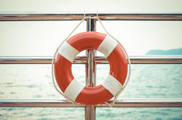 Vintage style photo of life preserver attached to the cruise shi