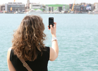 Tourist on holiday using mobile cell phone