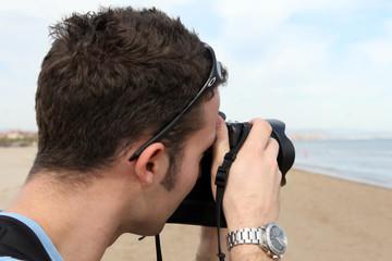 Close up of a photographer using a camera outdoors