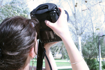 Close up of a photographer using a large camera