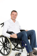 Portrait of charming man in wheelchair. Isolated on white