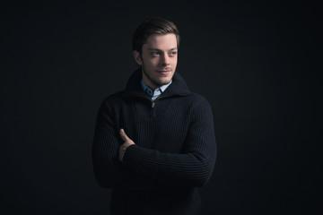 Man wearing dark blue winter sweater and blue shirt.
