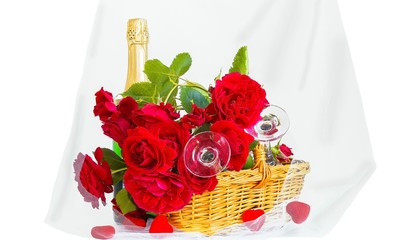 Roses and champagne on a white background