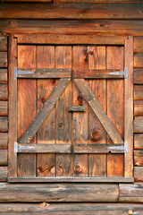 Closed Window Shutters of Log Home