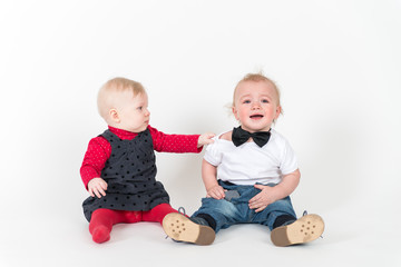 Two sitting kids on the white background
