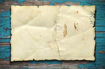 Old paper sheet on woodet table
