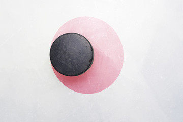 old hockey puck is on the ice with japan flag