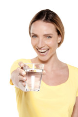 Portrait of a happy woman holding a glass of fresh water