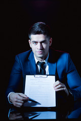 Man holding business formation agreement
