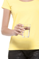 Holding a glass of fresh water