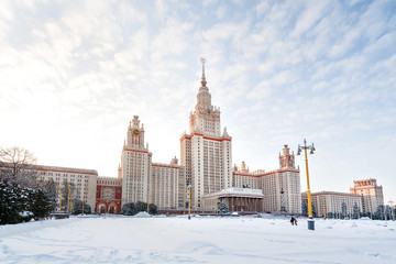 The main building of Moscow State University (MGU) in sunny winter day, Russia.