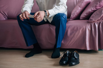 Businessman or groom wears shoes