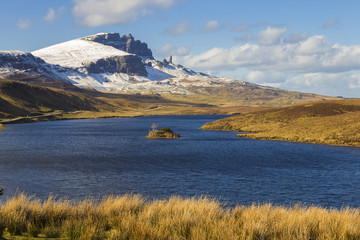 Wall Mural - Loch Fada and the famous snowy Old Man of Storr on a sunny spring morning - Isle of Skye, Scotland, UK