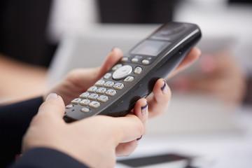 Radio phone in female hands