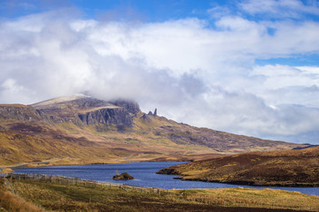Wall Mural - The famous Old Man of Storr on the Isle of Skye on a sunny spring day with blue sky and clouds - Scotland, UK