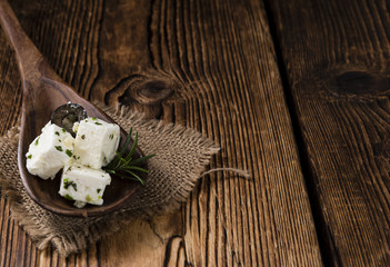 Feta Cheese (Marinated) on wooden backround