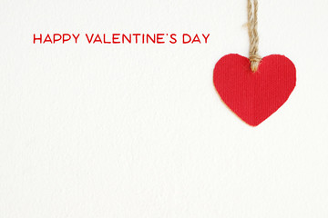 Happy valentine's day and red fabric heart shape