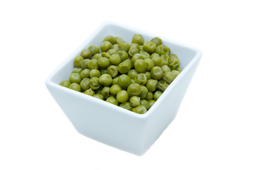 Cooked peas on square bowl on a white background