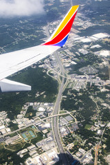 View from airplane window overlooking freeway