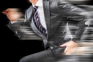 走る男性ビジネスマン