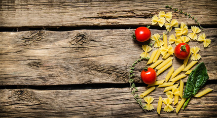 Dry pasta with cherry tomatoes and herb.
