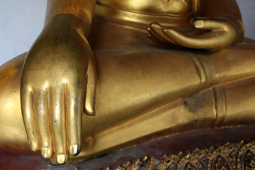 Hand of Golden Buddha statue stucco in different posture in long corridor of Wat Phra Chetuphon Vimolmangklararm Rajwaramahaviharn Temple (Locally known as Wat Pho Buddhist Temple), Bangkok, Thailand
