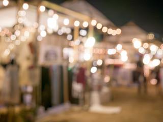 Blurred background: night market shopping with lighting decorati