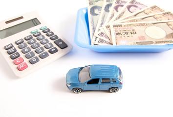 ミニカーと電卓とお金