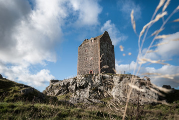 Lonely tower in the Scottish Borders perched on a rocky outcrop