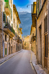 Wall Mural - View of an picturesque old town buildings street and mountains