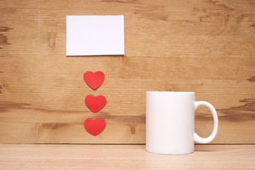 Heart and cup on a wooden background