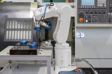 Mechanical hand robot working with CNC lathe machine