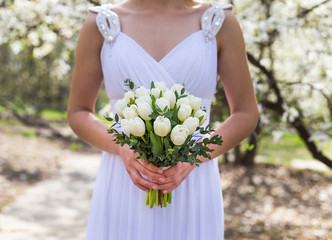Happy Bride with bouquet in sunny wedding day