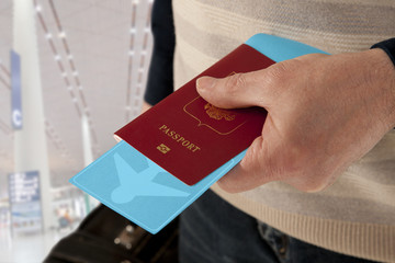 Passport and ticket in hand in airport