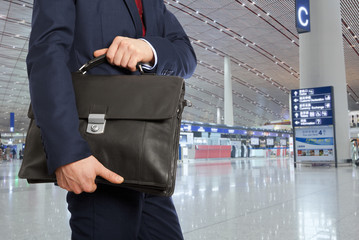 Businessman with a briefcase in airport