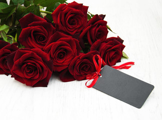 Red roses and greeting card