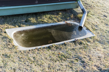 frozen water buried in the tub for irrigation