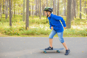 Little boy with skate board in park