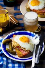 sandwich with sauerkraut , ham and fried eggs