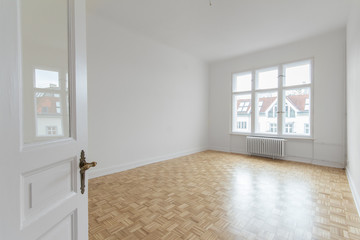 empty room, fresh renovated flat with wooden floor and white walls