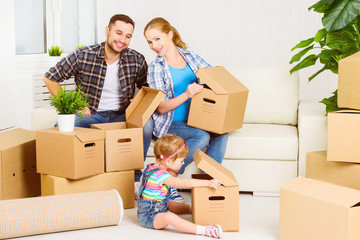 moving to new home. Happy family with cardboard boxes