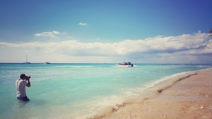 Tourist making picture of the carribean sea