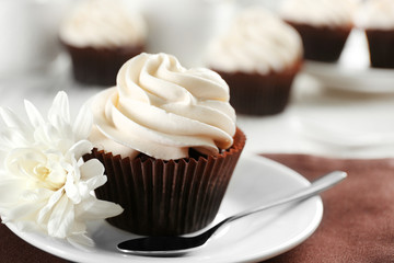 Tasty cupcake on served table, close up